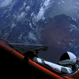 Starman sitting in Tesla Roadster orbiting Earth after being launched by SpaceX