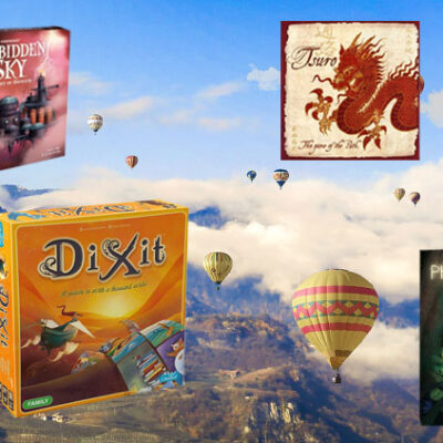 Board games against a background of hot air balloons floating over a valley